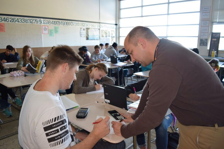 Mr. Bodine works one-on-one with a student