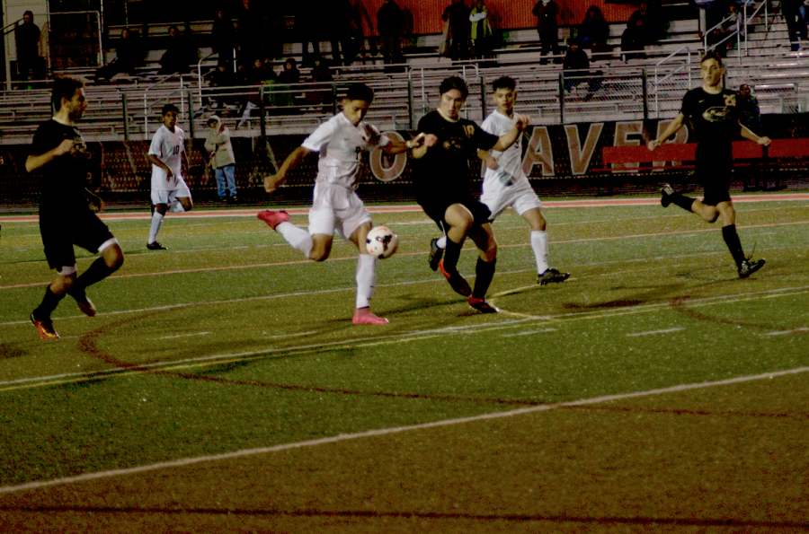 Jason Valtierra takes a shot at goal during Monday nights game against Southridge at home.