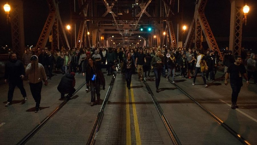 Protestors march on across the Hawthorne Bridge.