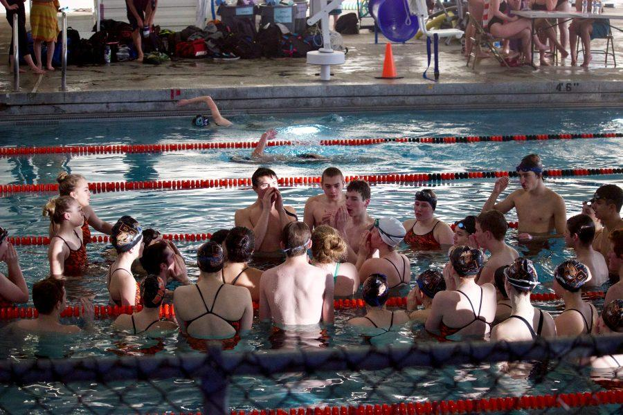 The Beaverton swim team huddles up to prepare for their forthcoming meet against the Century High Jaguars.