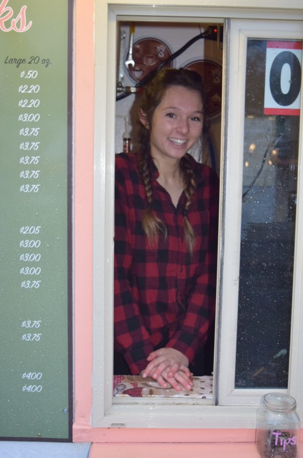 Piper Humphries serves up a smile and pep, along with customer's coveted coffee!
