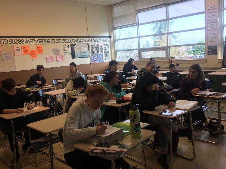 Students in Ms. Weber's AGS class solve a geometry problem. The new math curriculum has been met with controversy from both students and staff.