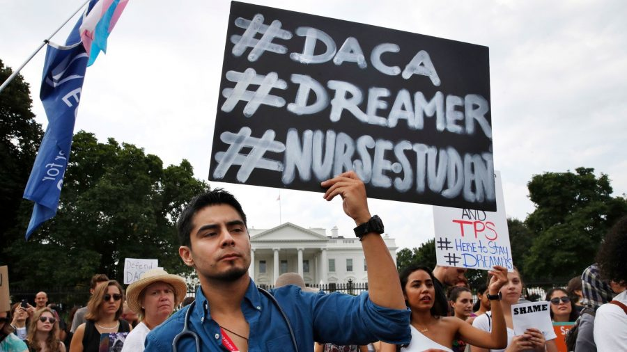 Dreamer+at+protest+holding+sign+that+explains+why+DACA+is+important+for+young+individuals+and+their+future.