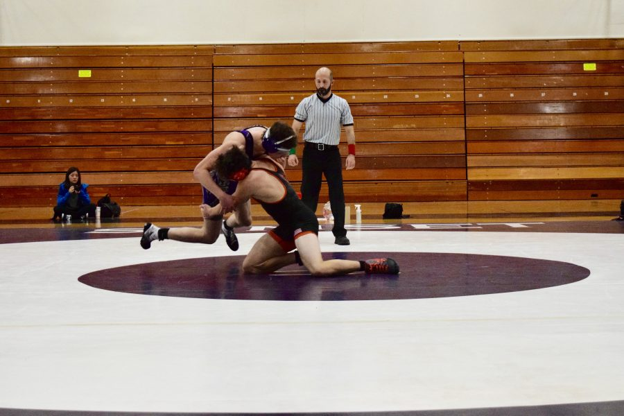 Senior Evan Kepner shoots for a two-point takedown in a close match against the Apollos on January 18th.
