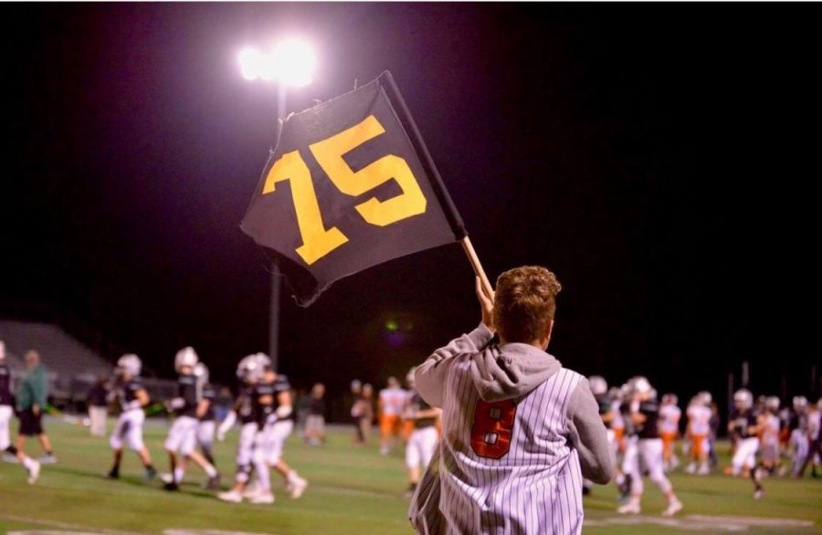 Football fans wave a flag with Reese's number on it in solidarity