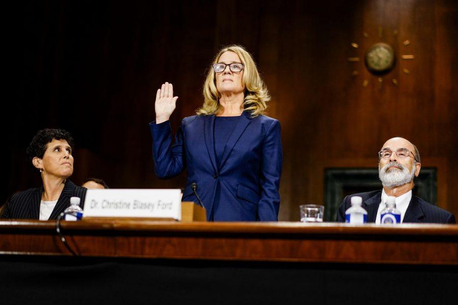 Dr. Christine Blasey Ford is sworn in before hertestimony against Judge Brett Kavanaugh