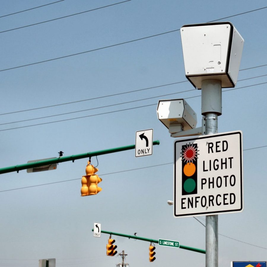 Red light enforcement cameras are implemented at am intersection.
