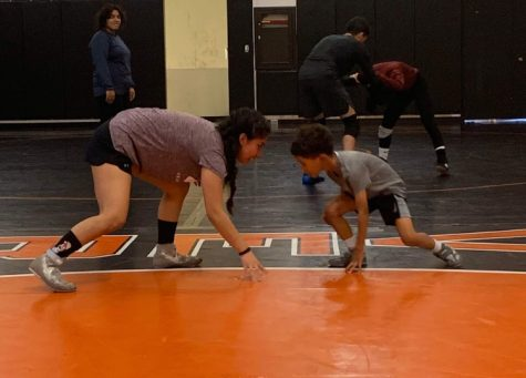 Wrestler Sylvia Almaguer faces off with an opponent