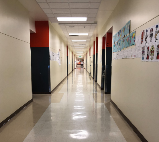 The main hallway in the Merle Davies building stretches on into oblivion, making it a challenge for some students to reach class on time.