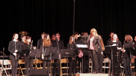 Band director Mary Bengel shows off the combined Concert and Symphonic Bands at their concert.
