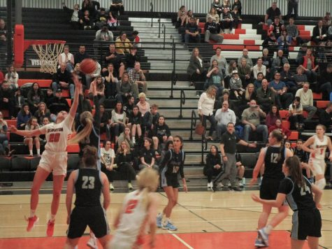 Beaverton player Laura Erikstrup and Mountainside player Carly Stone vie for the ball near the basket.