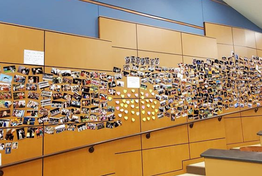 Photos and notes of encouragement line the walls of the Merle Davies Lecture Hall, where the Leadership class has been relocated.