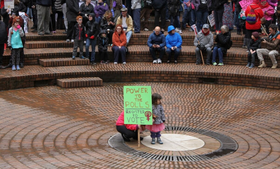 A woman encourages others to vote at Pioneer Square in Portland, OR.