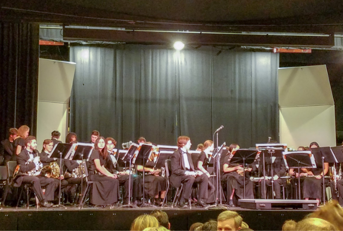 The high school Honor Band sits on the stage, awaiting director Pat Vandehey.