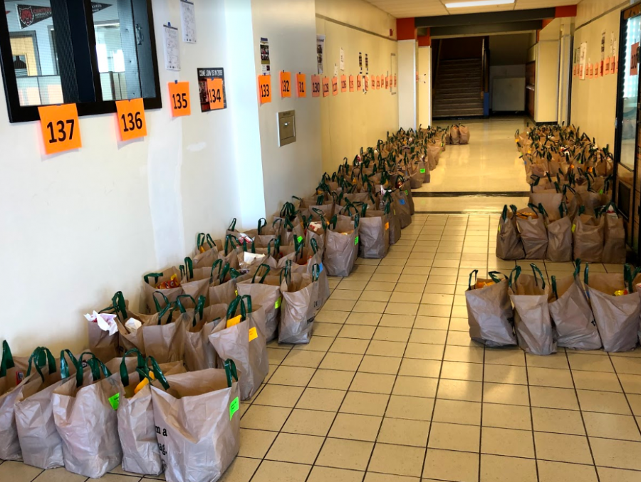 Bags of food line a hallway at Beaverton High School.