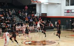 Beaverton player Mary Kay Naro hurls the ball across the court to her teammates.