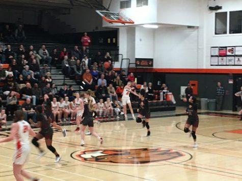 Beaverton player Mary Kay Naro hurls the ball across the court to her teammates.