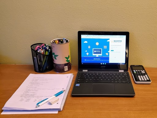 A workspace is set up at a student's home.