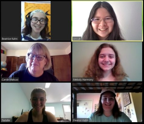 The Hummer team smiles together during a Zoom meeting.