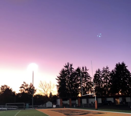 The sun sets over the Beaverton High School football field.