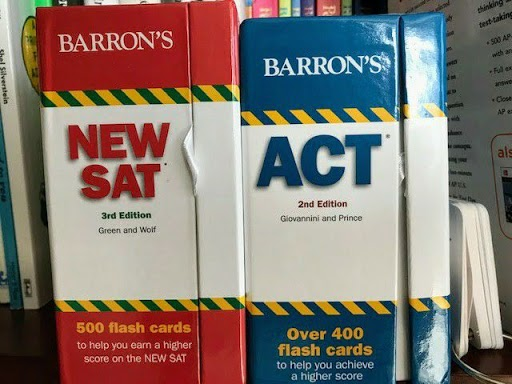 A set of SAT and ACT prep flashcards sit on a table.