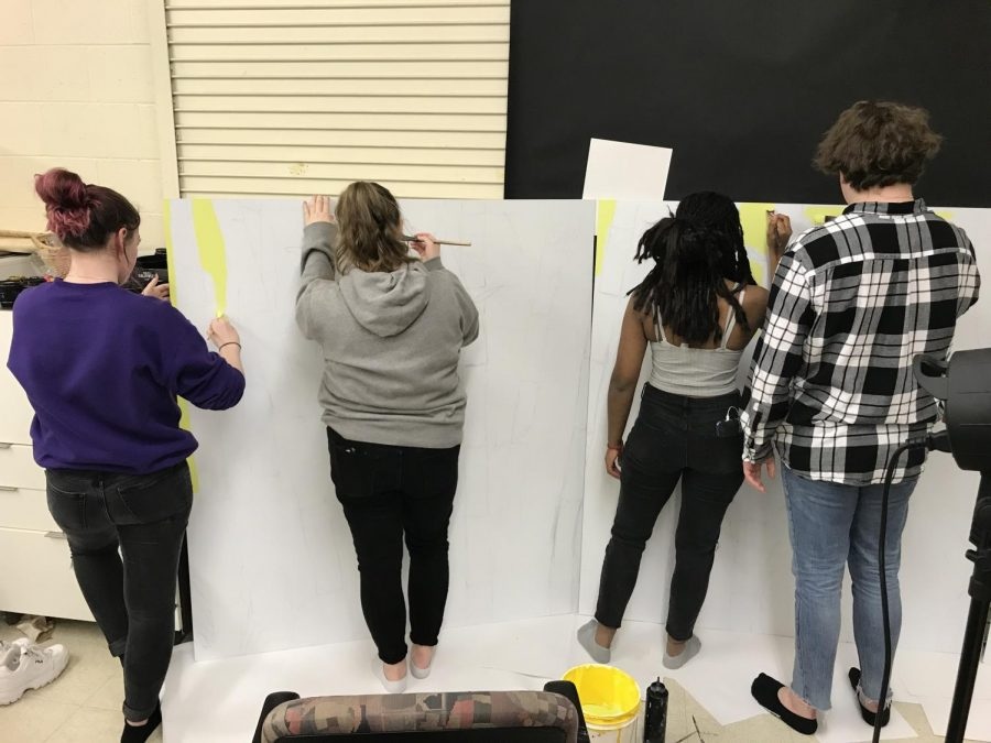 The four students work together on their mural prior to school closures,