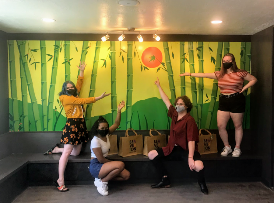 Student artists Alysha Taylor, Zoe Butler, Eddie Lundy, and Hannah Woffinden stand in front of their finished mural, which is on display at Yuubi Sushi in downtown Beaverton.