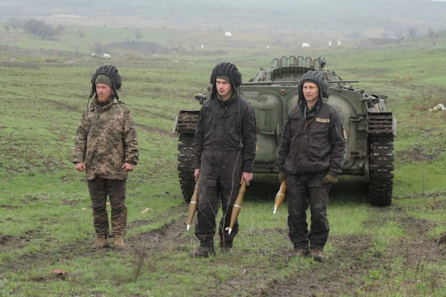 Ukrainian troops participate in a training activity as tension builds between Ukraine and Russia