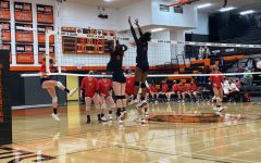 Varsity volleyball players Peyton Coleman and Amariah Clay jump to meet the ball during last Thursdays game against Westview.