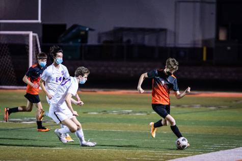 The Beaverton boys soccer team battles Sunset in a game in April